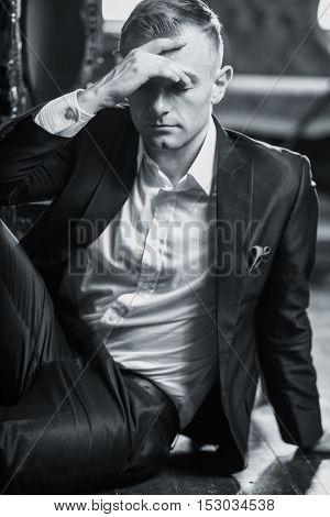 Vogue style image of a young man thinking possibly with depression