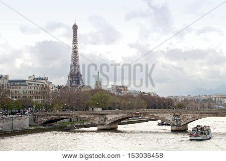 passenger cruise in river Seine with Eiffel Tower Paris France