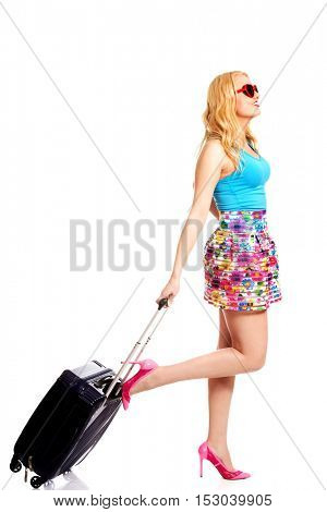 Smiling young woman with wheel bag going somewere.