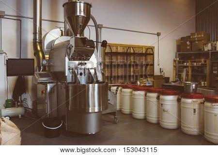 Iron coffee roasting machine at factory ready to use