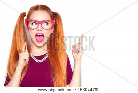 Surprised Teenage Gil holding funny paper glasses on stick, showing idea gesture. Joyful Excited Clever young woman ready for party, isolated on white background