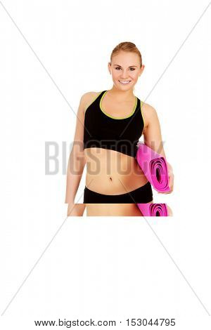 Woman ready for workout with yoga mats