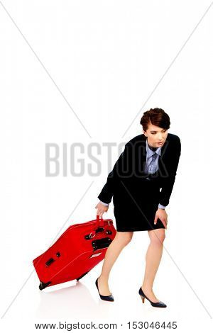 Tired businesswoman with suitcase.