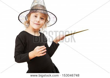Little Girl Dressed As A Witch With Magic Wand