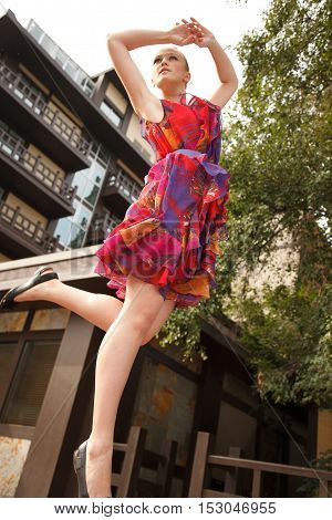 Stunning jumping girl outdoors in the city