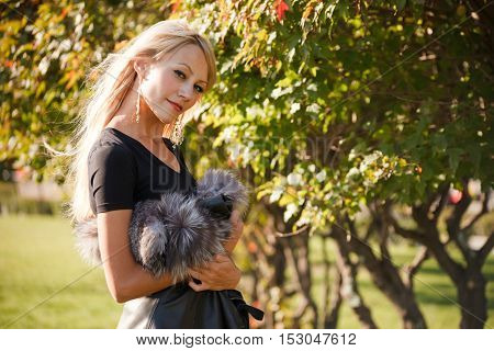 Young charming woman in the early autumn park