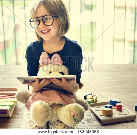 Little Girl Using Device Concept