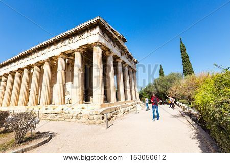 Athens, Greece - October 14, 2016: Tourists near temple of Hephaestus in Athens, Greece