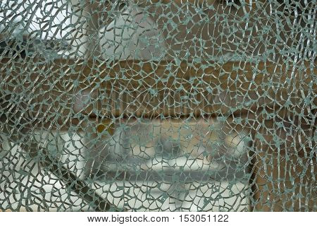 Broken glass with small cracks and a mosaic from slices
