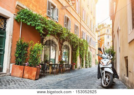 Beautiful street in Rome Italy. Vintage filter retro effect