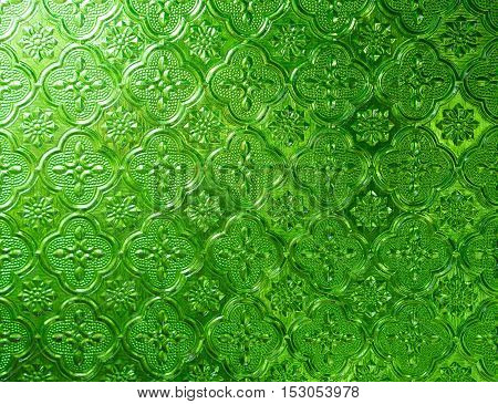 green glass light shines. of background texture.