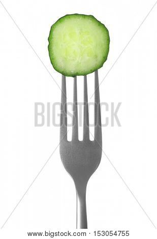 Fork with cucumber slice on white  background