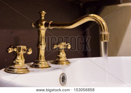 Gold Faucet And Washbasin Design Retro Vintage Decorated Luxury Interior Bathroom