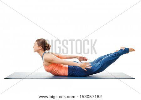 Woman doing Yoga asana Salabhasana B - locust pose B isolated on white background