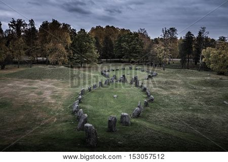 View of a pre historic burial ground in Sweden. Within the grave-field area there are many standing stones.