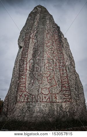 Closeup of a twelve hundered year old rune stone located at a large burial ground in Sweden.