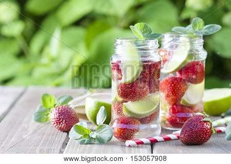 Strawberry and lime lemonade in a mason jar