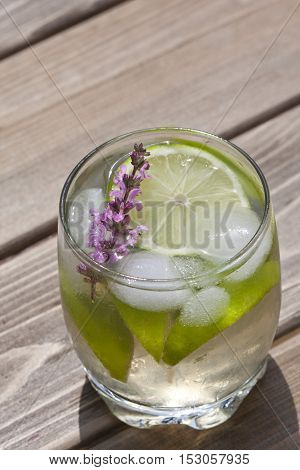 Glass of refreshing drink on a wooden table