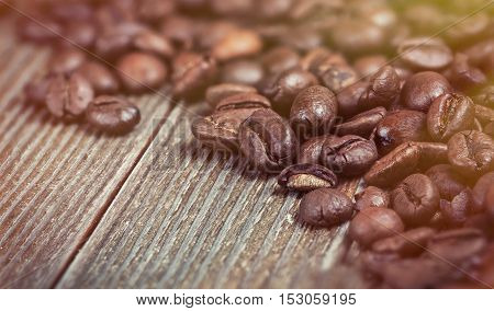 coffee beans on wooden background in old color