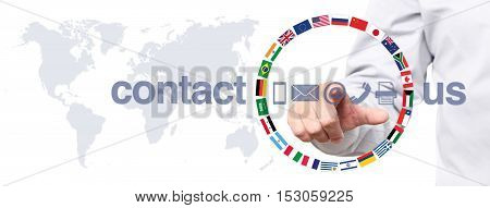 hand touch screen display with global contact us concept text flags and icons