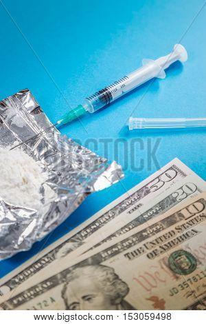 Drug syringe narcotic dangerous drug abuse pay money for drugs concept.
