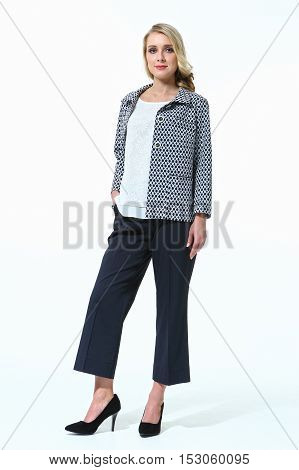 woman with straight hair style in culote trousers and jacket high heels shoes full length body portrait standing isolated on white
