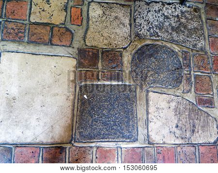 Variety of coloured Stone slabs in floor in English Pub