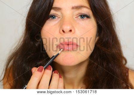 Woman pretty Make-up lips Lipgloss. Lipstick . Natural photo