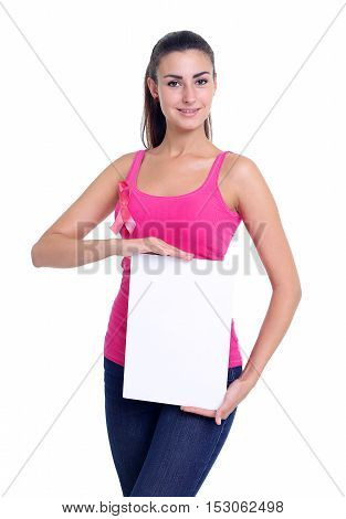 healthcare, people and medicine concept - close up of smiling women in shirts with pink breast cancer awareness ribbons and blank white board over white background