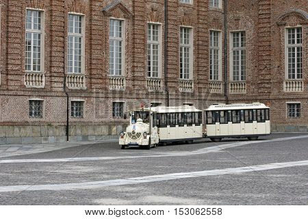 VENARIA REALE ITALY - OCTOBER 1: With this tourist train you can make a sightseeing tour in der Palast of Venaria Reale near Turin Italy on October 1 2016