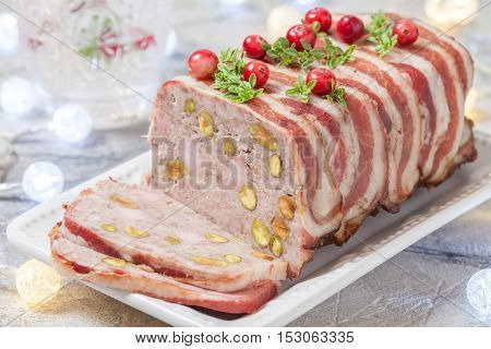 Delicious terrine with ground meat, ham and pistachios for Christmas
