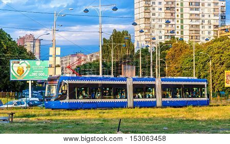 Kiev, Ukraine - August 15, 2016: Modern Pesa Twist tram on the Rapid Tram Line. The first tram appeared in Kiev in 1892, it was the first electric tram system in the Russian Empire.