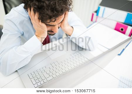 Sad businessman at his desk
