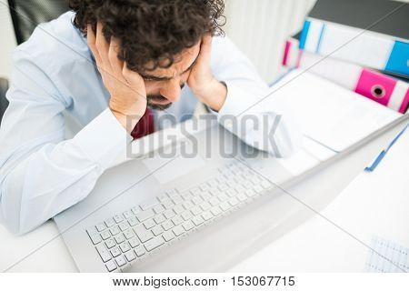 Sad businessman at his desk