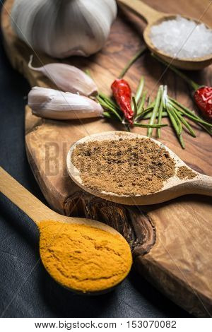 Spices On Rustic Wooden Table. Overhead View Food Photography.
