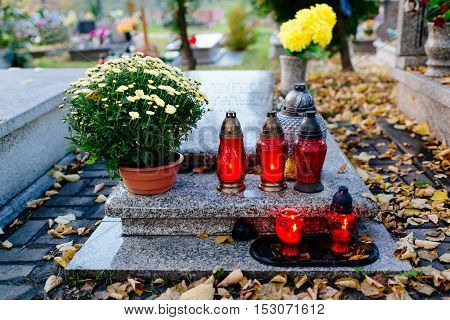Candles Burning At A Cemetery