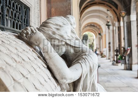 More than 170 years old statue. Cemetery located in North Italy.