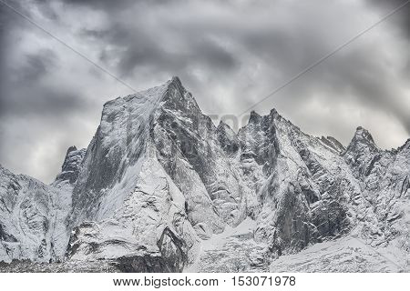 The North Face Of The Mountain Of The Rhaetian Alps In Switzerland. Pizzo Badile