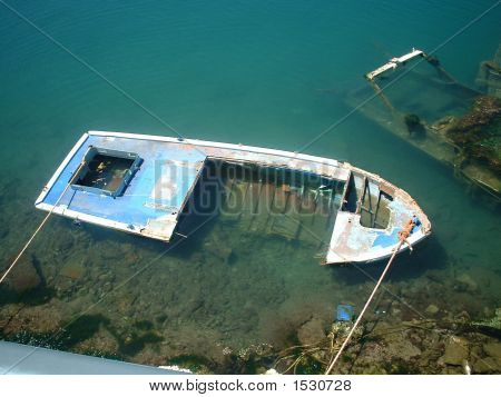 Sunken Boat In The Port Area Of Athens