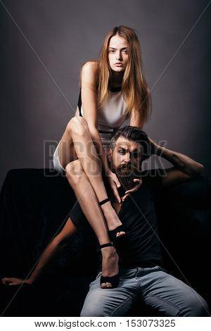 Pretty Girl Sits On Bearded Man
