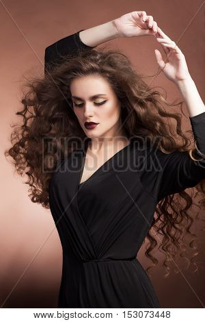 Sensual Woman With Perfect Make Up And Blowing Hairstyle