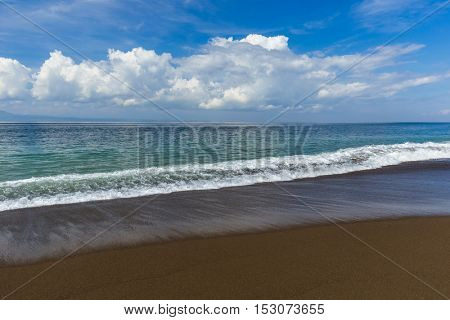 Black volcanic sand beach in Bali Island Indonesia - nature travel background