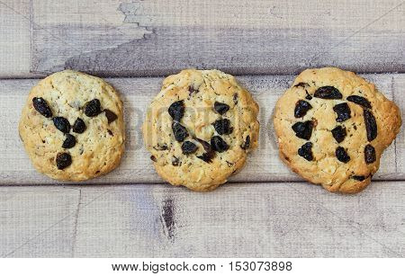 the word yum spelt out on cookie on wooden background