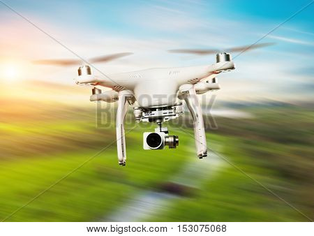 Drone flying above green field in blur motion
