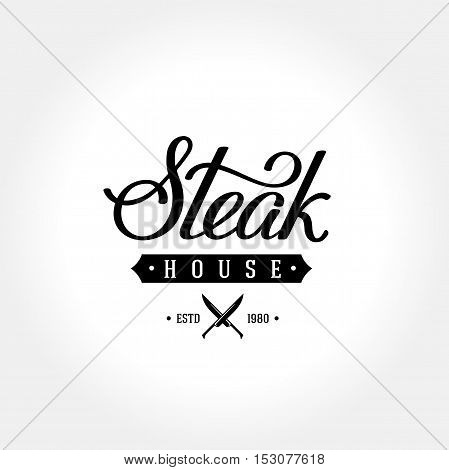 Steak house emblem with crossed knives. Handwritten calligraphy. Vector illustration.
