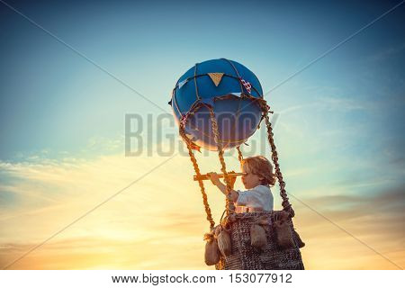 Little boy with a spyglass outdoors