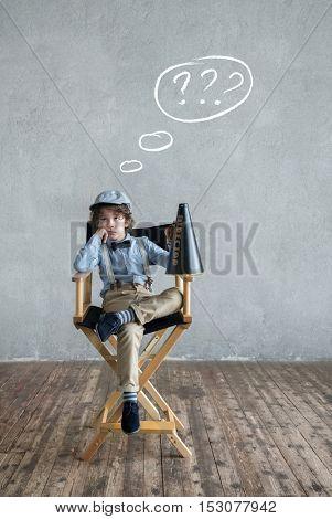 Little boy on a chair in studio