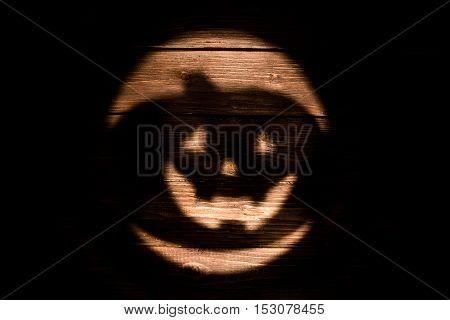 Halloween Jack-o'-lantern Of Shadow On Dark Wooden Background
