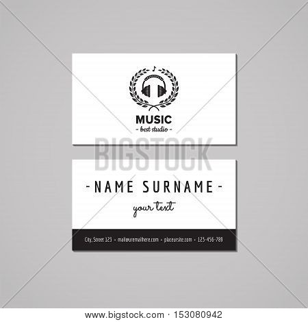Music studio business card design concept. Logo with headphones and wreath. Vintage hipster and retro style.
