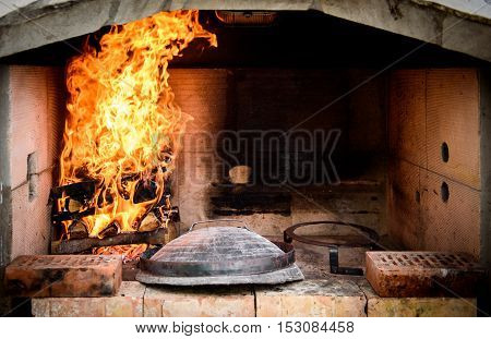 Preparing And Cooking Of Octopus In Traditional Croatian Peka Sach.